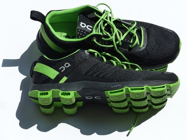 black and green running shoes repair