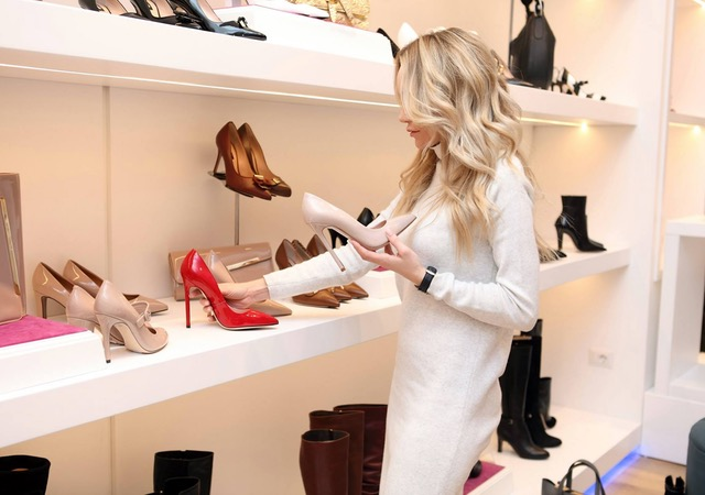 image of a woman shopping for shoes